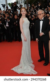 """CANNES, FRANCE - MAY 15, 2015: Emma Stone & director Woody Allen at the gala premiere for their movie """"Irrational Man"""" at the 68th Festival de Cannes."""