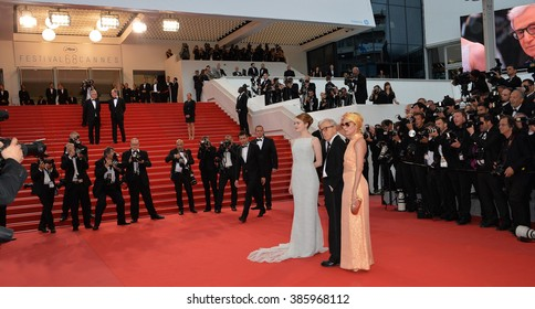 "CANNES, FRANCE - MAY 15, 2015: Emma Stone, Parker Posey & director Woody Allen at the gala premiere for their movie ""Irrational Man"" at the 68th Festival de Cannes."