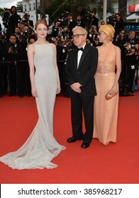 """CANNES, FRANCE - MAY 15, 2015: Emma Stone, Parker Posey & director Woody Allen at the gala premiere for their movie """"Irrational Man"""" at the 68th Festival de Cannes."""