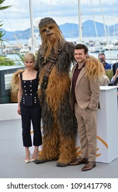 """CANNES, FRANCE. May 15, 2018: Chewbacca, Alden Ehrenreich & Emilia Clarke at the photocall for """"Solo: A Star Wars Story"""" at the 71st Festival de Cannes"""