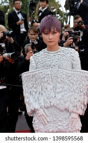 """CANNES, FRANCE. May 15, 2019: Amoy Corn at the gala premiere for """"Les Miserables"""" at the Festival de Cannes.Picture: Paul Smith / Featureflash"""