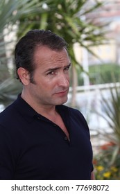 CANNES, FRANCE - MAY 15: Actor Jean Dujardin attends 'The Artist' photocall at the Palais des Festivals during the 64th Cannes Film Festival on May 15, 2011 in Cannes, France