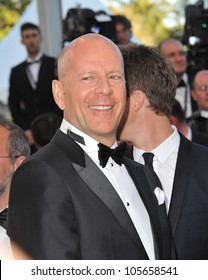 """CANNES, FRANCE - MAY 16, 2012: Bruce Willis at the premiere of his movie """"Moonrise Kingdom"""" - the gala opening movie at the 65th Festival de Cannes. May 16, 2012  Cannes, France"""