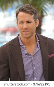 """CANNES, FRANCE - MAY 16, 2014: Ryan Reynolds at the photocall for his movie """"Captives"""" at the 67th Festival de Cannes."""