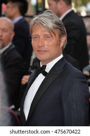 """CANNES, FRANCE - MAY 16, 2016: Actor Mads Mikkelsen at the gala premiere for """"Loving"""" at the 69th Festival de Cannes."""
