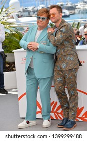 "CANNES, FRANCE. May 16, 2019: Elton John & Taron Egerton at the photocall for the ""Rocketman"" at the 72nd Festival de Cannes.
