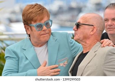 "CANNES, FRANCE. May 16, 2019: Elton John & Bernie Taupin at the photocall for the ""Rocketman"" at the 72nd Festival de Cannes.