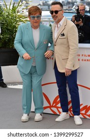 """CANNES, FRANCE. May 16, 2019: Elton John & David Furnish at the photocall for the """"Rocketman"""" at the 72nd Festival de Cannes.Picture: Paul Smith / Featureflash"""