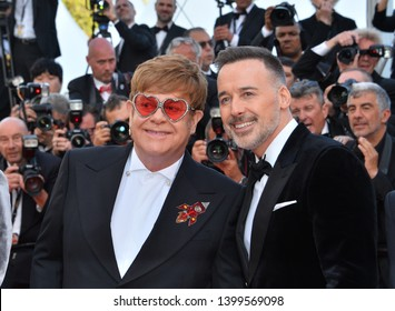 "CANNES, FRANCE. May 16, 2019: Sir Elton John & David Furnish at the gala premiere for ""Rocketman"" at the Festival de Cannes.