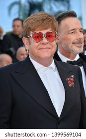 """CANNES, FRANCE. May 16, 2019: Sir Elton John & David Furnish at the gala premiere for """"Rocketman"""" at the Festival de Cannes.Picture: Paul Smith / Featureflash"""