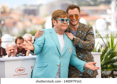 "CANNES, FRANCE - MAY 16, 2019:  Elton John and Actor attend Taron Egerton the photocall for ""Rocketman"" during the 72nd annual Cannes Film Festival"