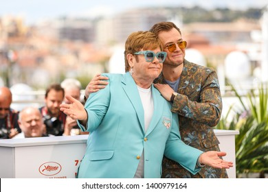"""CANNES, FRANCE - MAY 16, 2019:  Elton John and Actor attend Taron Egerton the photocall for """"Rocketman"""" during the 72nd annual Cannes Film Festival"""