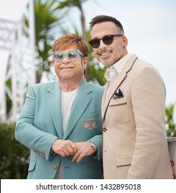 """CANNES, FRANCE. May 16, 2019: Elton John & David Furnish at the photocall for the """"Rocketman"""" at the 72nd Festival de Cannes."""