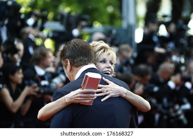 CANNES, FRANCE - MAY 16: Actress Jane Fonda greets actor Alec Baldwin during the Opening Ceremony at 65th Annual Cannes Film Festival at Palais des Festivals on May 16, 2012 in Cannes, France.