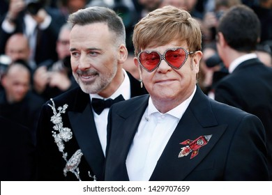 """CANNES, FRANCE - MAY 16: Elton John, David Furnish attend the premiere of the movie """"Rocketman"""" during the 72nd Cannes Film Festival on May 16, 2019 in Cannes, France."""