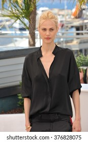"""CANNES, FRANCE - MAY 17, 2014: Aymeline Valade at photo call for her movie """"Saint-Laurent"""" at the 67th Festival de Cannes."""