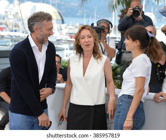 """CANNES, FRANCE - MAY 17, 2015: Vincent Cassel, Emmanuelle Bercot & director Maiwenn at the photocall for their movie """"My King"""" (Mon Roi) at the 68th Festival de Cannes."""