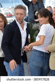 """CANNES, FRANCE - MAY 17, 2015: Vincent Cassel & director Maiwenn at the photocall for their movie """"My King"""" (Mon Roi) at the 68th Festival de Cannes."""