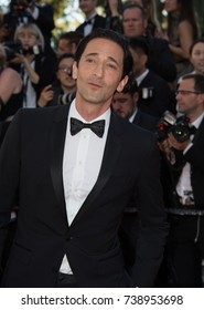 """CANNES, FRANCE. May 17, 2017: Adrien Brody at the premiere for """"Ismael's Ghosts"""" at the opening ceremony of the 70th Festival de Cannes"""