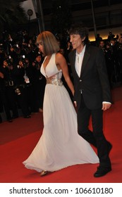 "CANNES, FRANCE - MAY 18, 2011: Ronnie Wood & Ana Araujo at the premiere of ""Melancholia"" at the 64th Festival de Cannes. May 18, 2011  Cannes, France"