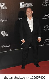 "CANNES, FRANCE - MAY 18, 2012: Harvey Weinstein at the ""Haiti Carnaval in Cannes"" party at the 65th Festival de Cannes. May 18, 2012  Cannes, France"