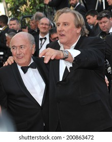 """CANNES, FRANCE - MAY 18, 2014: Gerard Depardieu & FIFA boss Sepp Blatter at the gala premiere of """"The Homesman"""" at the 67th Festival de Cannes."""