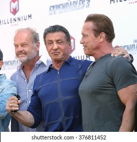 """CANNES, FRANCE - MAY 18, 2014: Kelsey Grammer, Sylvester Stallone & Arnold Schwarzenegger at the photocall for their movie """"The Expendables 3"""" on the Croisette at the 67th Festival de Cannes."""
