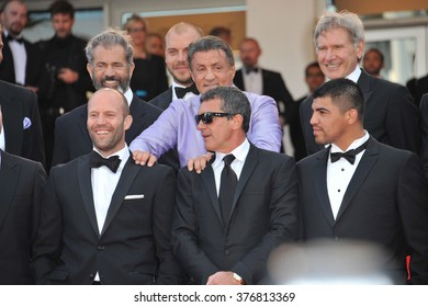 """CANNES, FRANCE - MAY 18, 2014: Cast of The Expendables 3 promoting their new movie """"The Expendable 3"""" at the 67th Festival de Cannes."""