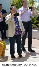 """CANNES, FRANCE - MAY 18, 2015: Disney Pixar boss John Lasseter & director Pete Docter at the photocall for their movie """"Inside Out"""" at the 68th Festival de Cannes."""