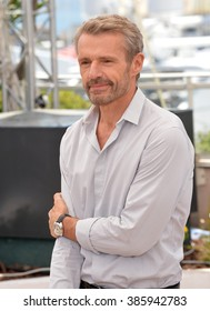 """CANNES, FRANCE - MAY 18, 2015: Lambert Wilson at the photocall for his movie """"Enrages"""" at the 68th Festival de Cannes."""