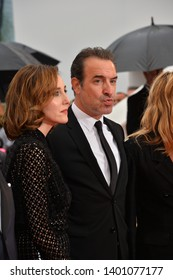 """CANNES, FRANCE. May 18, 2019: Jean Dujardin & Elsa Zylberstein  at the gala premiere for """"The Most Beautiful Years of a Life"""" at the Festival de Cannes.Picture: Paul Smith / Featureflash"""