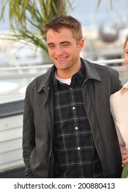 """CANNES, FRANCE - MAY 19, 2014: Robert Pattinson at the photocall for his movie """"Maps to the Stars"""" at the 67th Festival de Cannes."""