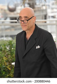 """CANNES, FRANCE - MAY 19, 2014: Bruce Wagner at the photocall for his movie """"Maps to the Stars"""" at the 67th Festival de Cannes."""