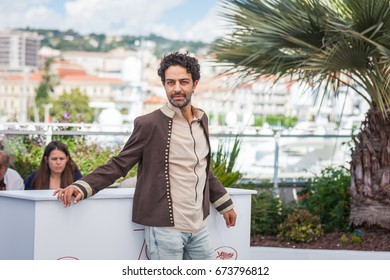 CANNES, FRANCE - MAY 19, 2017: Actor Ghanem Zrelli attends 'Alaka Kaf Ifrit (La Belle Et La Meute)' Photocall during the 70th annual Cannes Film Festival at Palais des Festivals