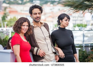 CANNES, FRANCE - MAY 19, 2017: Director Kaouther Ben Hania, Actors Ghanem Zrelli and Mariam Al Ferjani attend 'Alaka Kaf Ifrit (La Belle Et La Meute)' Photocall during 70th annual Cannes Film Festival