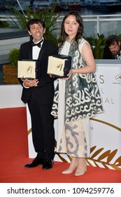 "CANNES, FRANCE. May 19, 2018: Samal Yeslyamova & Marcello Fonte at the photocall for ""Award Winners"" at the 71st Festival de Cannes"
