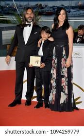 "CANNES, FRANCE. May 19, 2018: Nadine Labaki, Zain Alrafeea & Khaled Mouzanar at the photocall for ""Award Winners"" at the 71st Festival de Cannes"