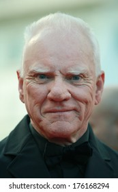 """CANNES, FRANCE - MAY 19: British actor Malcolm McDowell poses on the red carpet before the screening of """"The Skin I Live In"""" at the 64th Cannes Film Festival on May 19, 2011 in Cannes."""