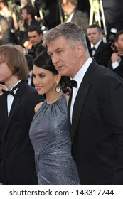 "CANNES, FRANCE - MAY 20, 2013: Alec Baldwin & wife Hilaria Thomas at the gala premiere for ""Blood Ties"" at the 66th Festival de Cannes."