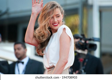 CANNES, FRANCE - MAY 20, 2014: Actress Amber Heard walks down the red carpet during the 67th Annual Cannes Film Festival on May 20, 2014 in Cannes, France.
