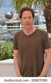"""CANNES, FRANCE - MAY 20, 2014: Reda Kateb at the photocall for his movie """"Lost River"""" at the 67th Festival de Cannes."""