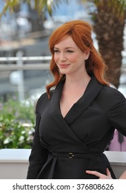 """CANNES, FRANCE - MAY 20, 2014: Christina Hendricks at the photocall for her movie """"Lost River"""" at the 67th Festival de Cannes."""