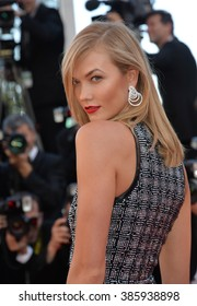 """CANNES, FRANCE - MAY 20, 2015: Karlie Kloss at the gala premiere for """"Youth"""" at the 68th Festival de Cannes."""