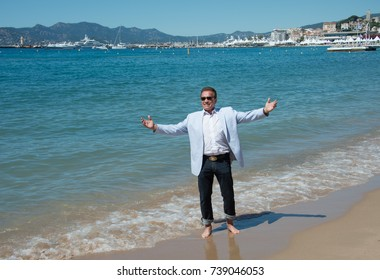"CANNES, FRANCE. May 20, 2017: Arnold Schwarzenegger at the photocall for ""Wonders of the Sea 3D"" on the beach at the 70th Festival de Cannes"