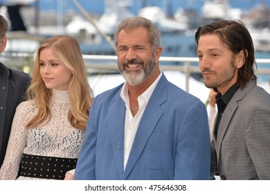 """CANNES, FRANCE - MAY 21, 2016: Actors Mel Gibson, Erin Moriarty & Diego Luna at the photocall for """"Blood Father"""" at the 69th Festival de Cannes."""