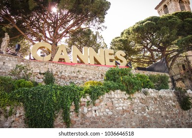 CANNES, FRANCE — MAY 21, 2017: The famous landmark sign of Cannes written in light bulbs in the heights of le Suquet.