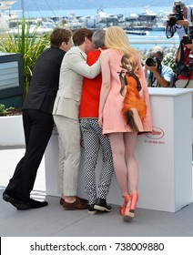 "CANNES, FRANCE. May 21, 2017: AJ Lewis, Alex Sharp, Elle Fanning & John Cameron Mitchell at the photocall for ""How To Talk To Girls At Parties"" at the 70th Festival de Cannes"