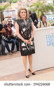 CANNES, FRANCE - MAY 21: Actress Catherine Deneuve attends 'L'Homme Qu'On Aimait Trop' photocall at the 67th Annual Cannes Film Festival on May 21, 2014 in Cannes, France.