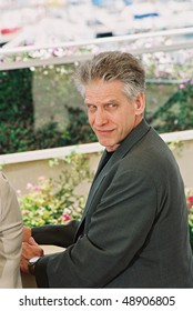 CANNES, FRANCE - MAY 21: Canadian director David Cronenberg poses during a photocall for his film 'Spider' during the 55th Cannes Film Festival May 21, 2002 in Cannes, France