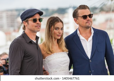 """CANNES, FRANCE - MAY 22, 2019: Brad Pitt, Margot Robbie and Leonardo DiCaprio attend thephotocall for """"Once Upon A Time In Hollywood"""" during the 72nd annual Cannes Film Festival"""